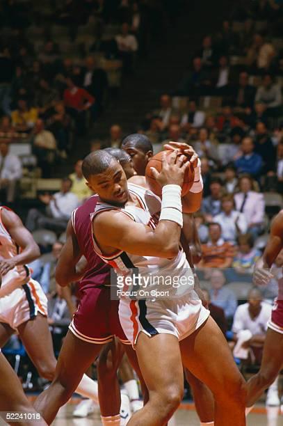 University of Auburn's Center Charles Barkley grabs a rebound in a circa 1980s game