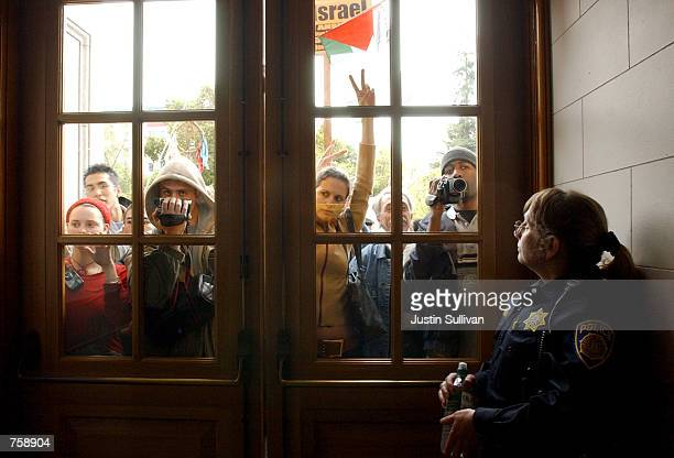 University of California at Berkeley police officer Debra Schnek guards a door to a building where dozens of proPalestinian demonstrators held a...