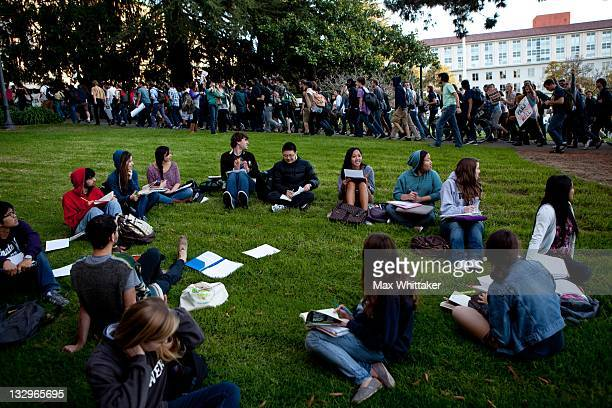 University of California Berkeley students hold a teachout as other students march through campus as part of an open university strike in solidarity...