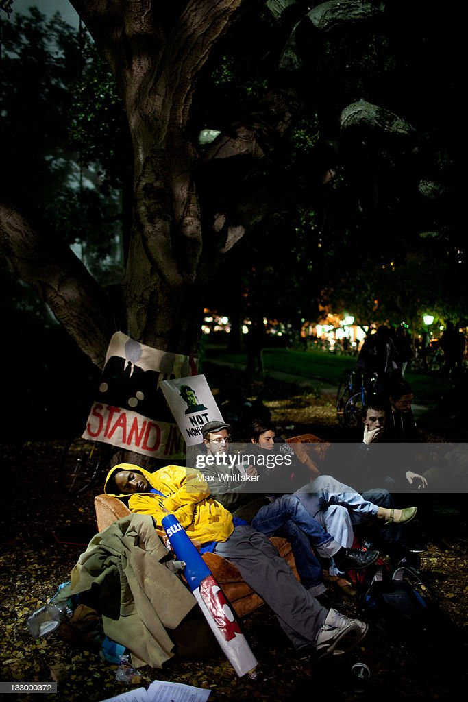 University of California, Berkeley students relax on a couch as fellow protesters hold a general assembly on campus as part of an 'open university' strike in solidarity with the Occupy Wall Street movement on November 15, 2011 in Berkeley, California. Teach-outs, workshops, public readings, and marches will culminate in an attempt to re-establish an Occupy Cal encampment that was shut down by police last week.