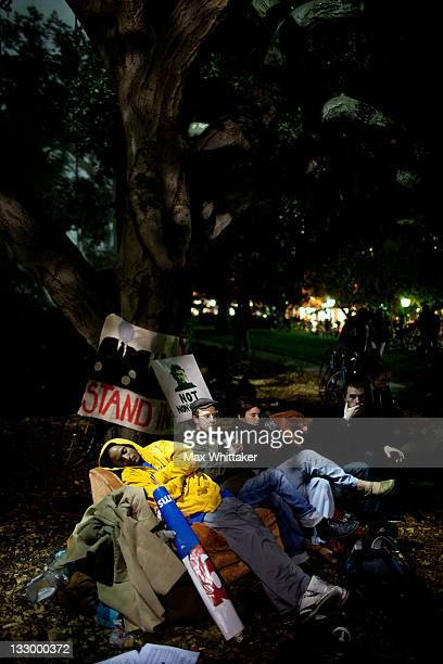 University of California Berkeley students relax on a couch as fellow protesters hold a general assembly on campus as part of an 'open university'...