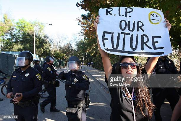 University of California Los Angeles student Andrea Flores challenges campus police as students and supporters protest after the UC Board of Regents...