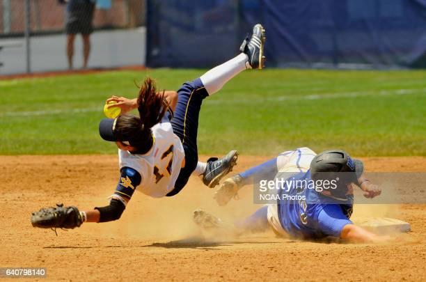 University of California San Diego shortstop Mya Romero tumbles as she forces out Stephanie Needham of the University of Alabama-Huntsville during...