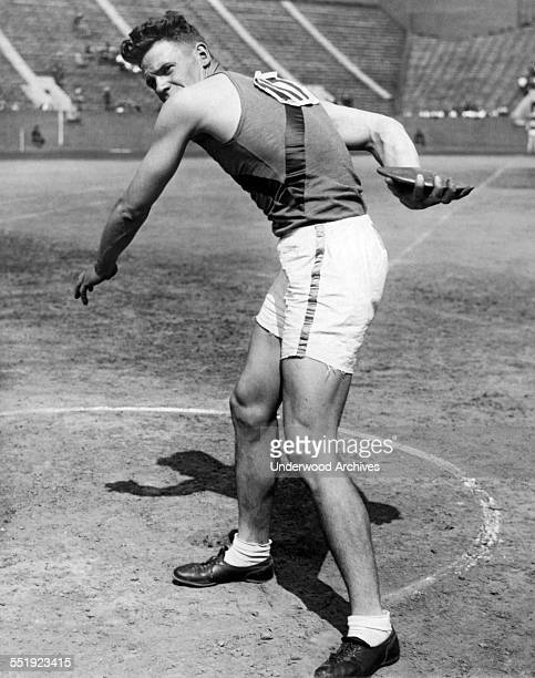 University of California star Bill Neufeldt as he throws the discus at the Intercollegiate AAAA track and field meet at Franklin Field at the...