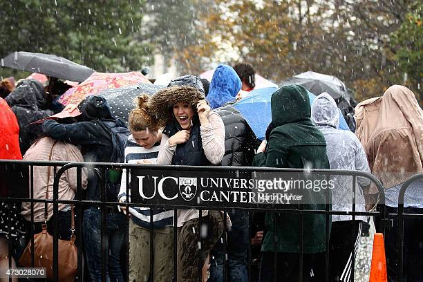 University of Canterbury students react to heavy rain while waiting for the arrival of Prince Harry on May 12 2015 in Christchurch New Zealand Prince...