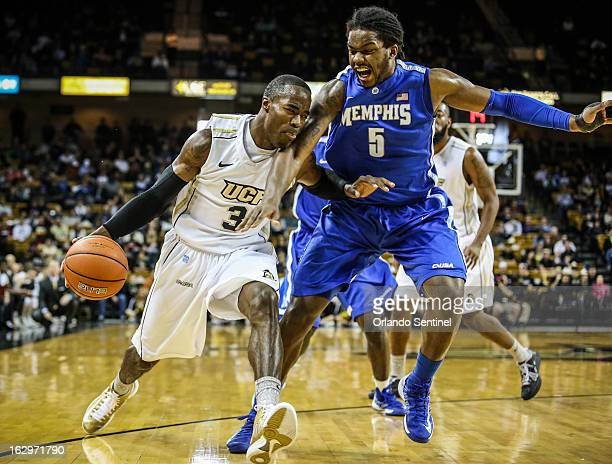 University of Central Florida guard Isaiah Sykes drives against Memphis' Shaq Goodwin in the first half at UCF Arena in Orlando Florida Saturday...