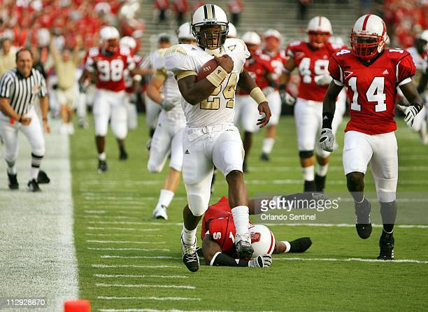 University of Central Florida tailback Kevin Smith breaks away from North Carolina State players during an 80yard touchdown return early in the game...
