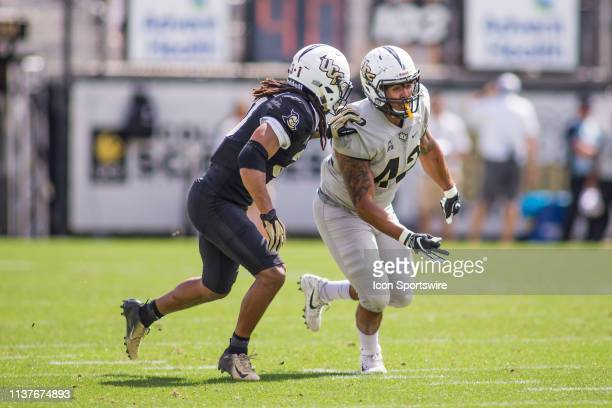 University of Central Florida tight end Tyler Williams runs a route as defensive back Aaron Robinson defends in the UCF Football Spring Game on April...