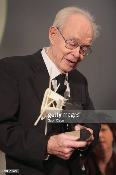 University of Chicago astrophysicist Dr Eugene Parker is presented with a model of the Parker Solar Probe at an event where NASA officials announced...