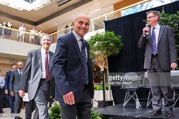 University of Chicago professor Eugene F. Fama, one of three receipients of the 2013 Nobel Prize in Economics enters a news conference at the Chicago...