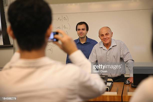 University of Chicago professor Eugene Fama poses for a picture with a student after teaching a class at the university on October 14, 2013 in...