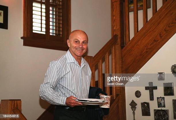 University of Chicago professor Eugene Fama prepares to leave home to teach his morning class after learning he had won the Nobel Prize in Economic...