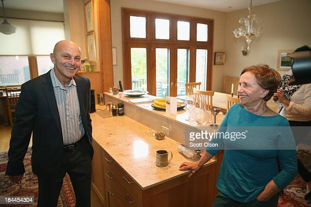 University of Chicago professor Eugene Fama, with his wife Sally, prepares to leave home to teach his morning class after learning he had won the...