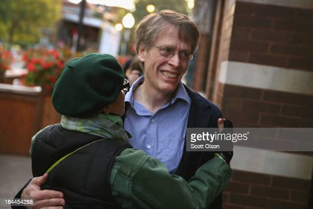 University of Chicago professor Lars Peter Hansen is congratulated by friends outside a coffee shop near his home after learning he had won the Nobel...