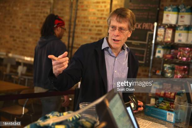 University of Chicago professor Lars Peter Hansen meets friends at a coffee shop near his home after learning he had won the Nobel Prize in Economic...
