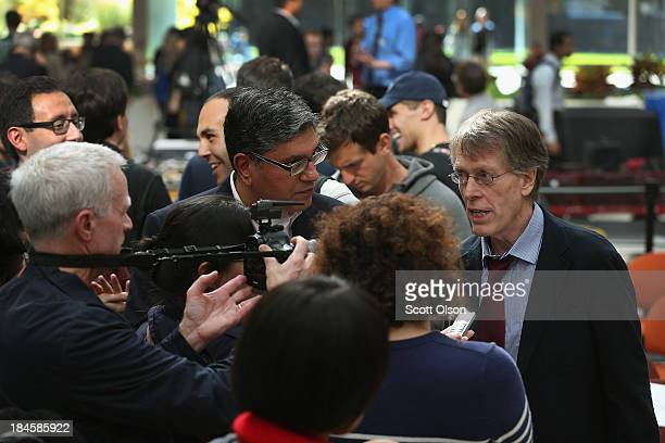 University of Chicago professor Lars Peter Hansen speaks to reporters after learning he had won the Nobel Prize in Economic Sciences on October 14,...