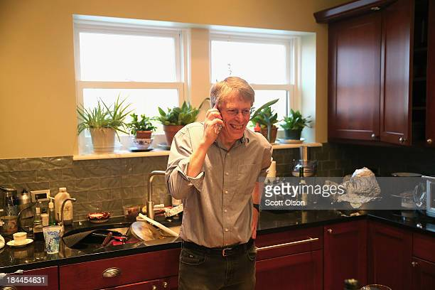 University of Chicago professor Lars Peter Hansen takes a call in his home after learning he had won the Nobel Prize in Economic Sciences on October...