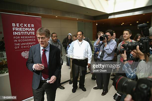 University of Chicago professor Lars Peter Hansen takes a takes a sip of champagne during a toast to celebrate his winning of the Nobel Prize in...