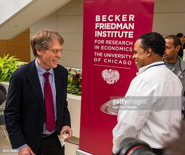 University of Chicago professors Lars Peter Hansen, one of three recipients of the 2013 Nobel Prize in Economics grabs a glass of champagne after a...