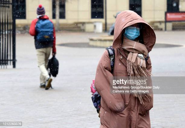 University of Colorado Boulder student Lily Chan walks across campus on March 13 2020 n