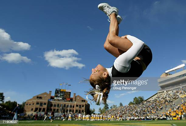 University of Colorado Buffaloes cheerleader does a flip during warm ups as they faced the Arizona State Sun Devils at Folsom Field on September 16...