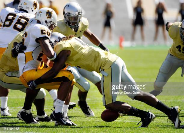 University of Colorado Buffaloes football take on the Wyoming Cowboys in the second quarter at Folsom Field in Boulder CU's Benjamin Burney forces...
