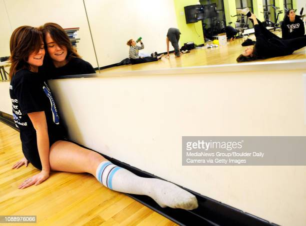 University of Colorado freshman dancer Haylie Harwood stretches her legs in front of the mirror on Thursday Feb 24 during the The CU Buff Gold Dance...