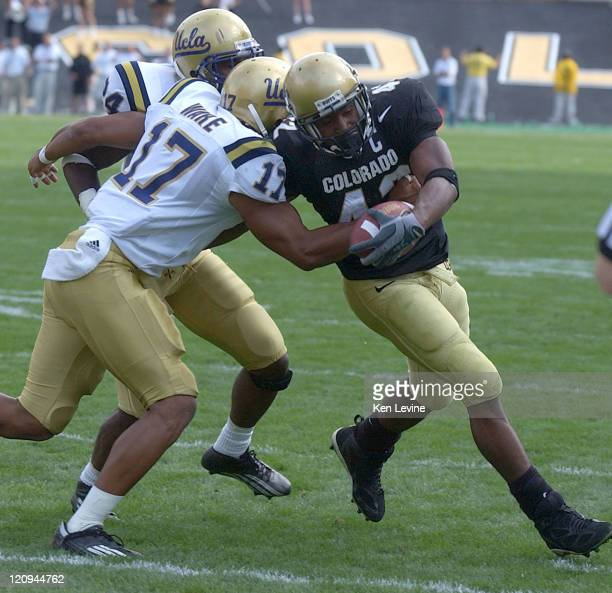 University of Colorado running back Bobby Purify gets tackledat the UCLA 6 yard line by UCLA's Matt Ware and Ben Emanuel II during the fourth quarter...