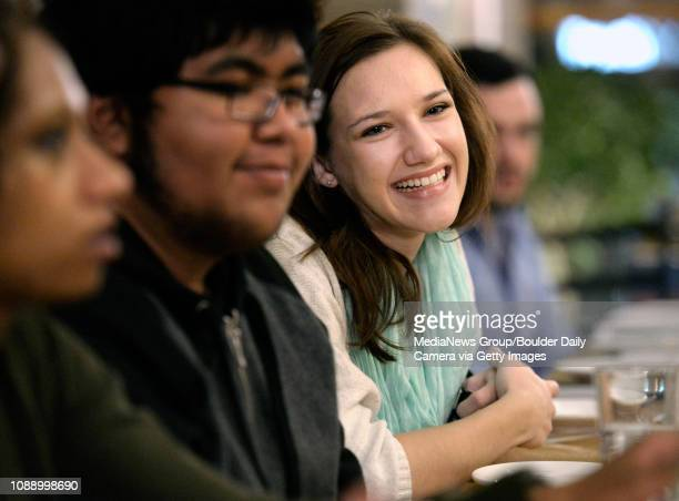 University of Colorado senior Alexis Petre, at right, freshman Jesus Ortiz-Tovar and senior Neelah Ali laugh while talking during a dinner to discuss...