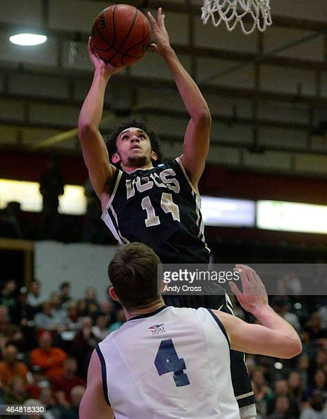 University of Colorado Springs guard Derrick White shoots over Nicholas Kay Metro State in the second half of play at Metro State February 27 2015