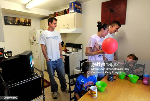 University of Colorado student Jonathan Wezner left his wife Amber brother Matt Wezner and his children Ayden front left and Ashlyn getting ready for...