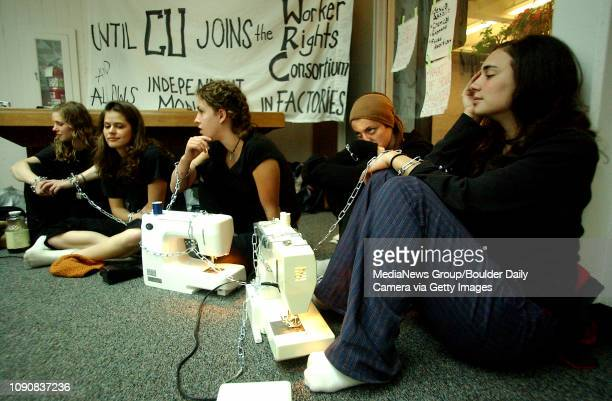 University of Colorado students from left Virginia Cutshall Yeldah Brown Jordan Brown Kate Traynor and Faye Hipsman chain themselves to sewing...
