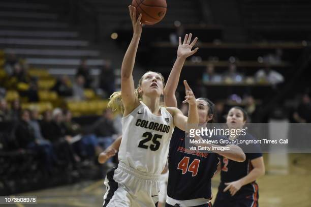 University of Colorado's Annika Jank goes for a layup during a NCAA game against Pepperdine University on Tuesday at the Coors Event Center on the CU...
