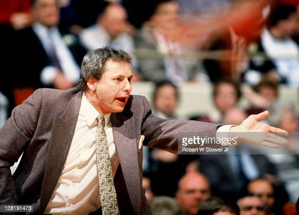 University of Connecticut assistant coach Howie Dickenman protests call during a game, Hartford CT 1990.