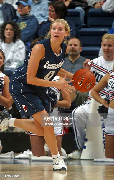 University of Connecticut basketball player Ann Strother with the ball during a game at Gampel Pavilion, Storrs, Connecticut, November 8, 2003.
