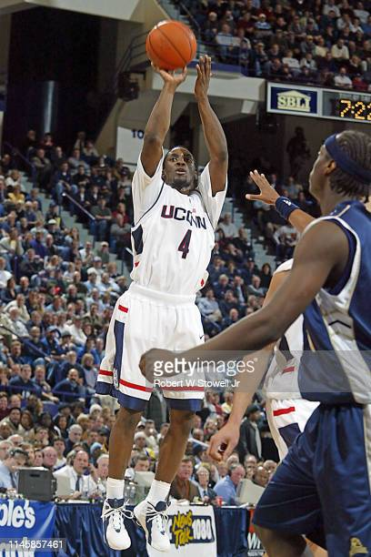 University of Connecticut basketball player Ben Gordon shoots over the defense during a game against Pittsburgh, Hartford, Connecticut, June 30, 2002.