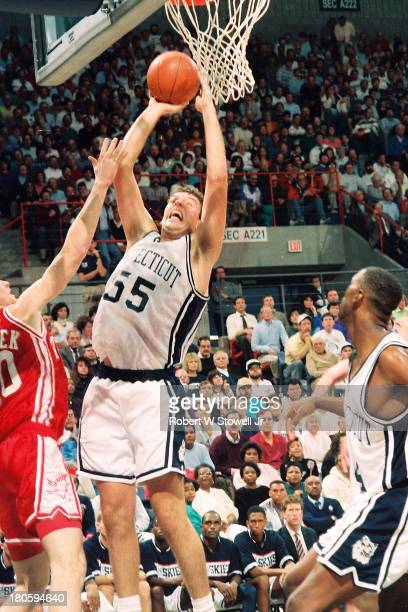 University of Connecticut basketball player Dan Cyrulik goes up strong while shooting from the baseline, Storrs, Connecticut, 1992.
