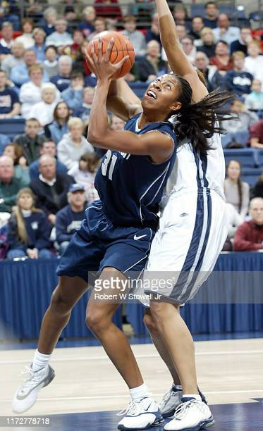 University of Connecticut basketball player Jessica Moore with the ball during a game at Gampel Pavilion, Storrs, Connecticut, April 19, 2002.
