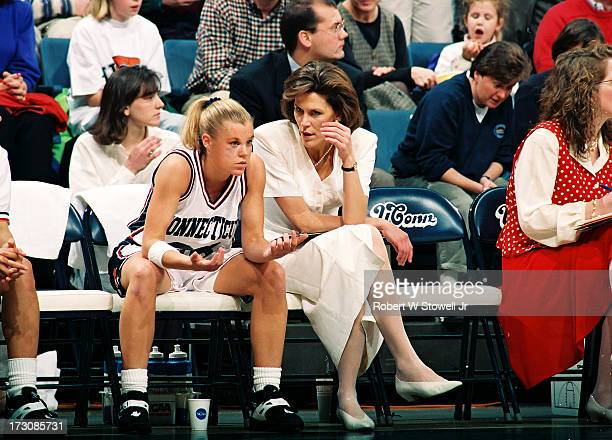 University of Connecticut basketball player Pam Weber listens to assistant coach Chris Dailey on the bench during a game Storrs Connecticut 1995