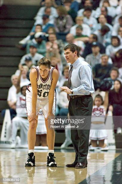 University of Connecticut coach Geno Auriemma strategizes with his star player Rebecca Lobo during a break in the action in a basketball game at...