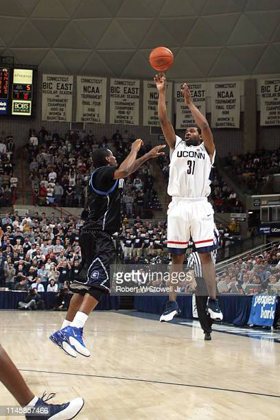University of Connecticut guald Rashad Anderson shoots a three pointer over the Georgetown defense in a game held Storrs Connecticut January 14 2004