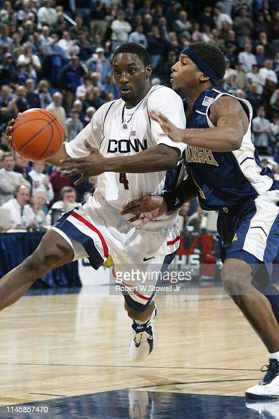 University of Connecticut guard Ben Gordon drives during a game against Pittsburgh, Hartford, Connecticut, June 30, 2002.