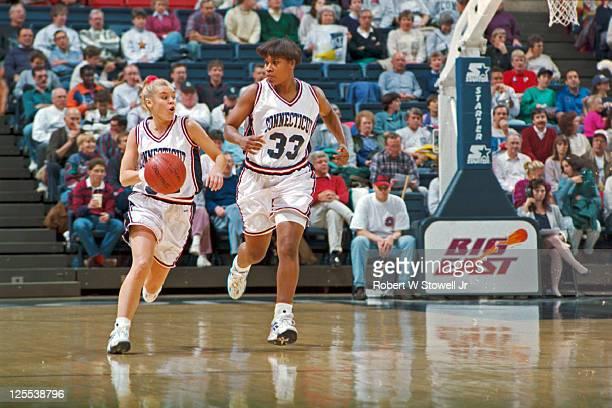 University of Connecticut guard Pam Weber left brings up the ball on a fast break while teammate Jamelle Elliot runs alongside her Storrs CT 1995
