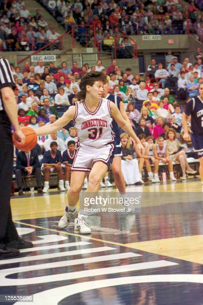 University of Connecticut guard Wendy Davis looks upcourt as she tiptoes along the baseline while an opposing player looks on Storrs CT 1991