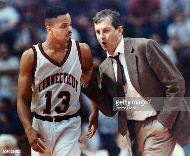 University of Connecticut Jim Calhoun right speaks with Chris Smith left during the first round of the NCAA game against Boston University at the...