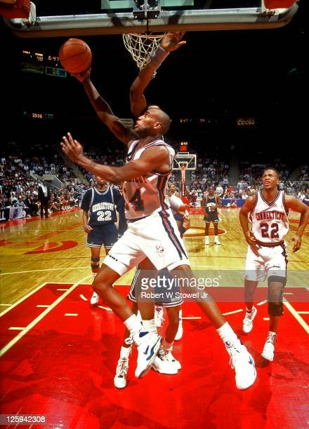 University of Connecticut player Scott Burrell goes in for a reverse layup against Big East rival Georgetown Hartford CT 1990