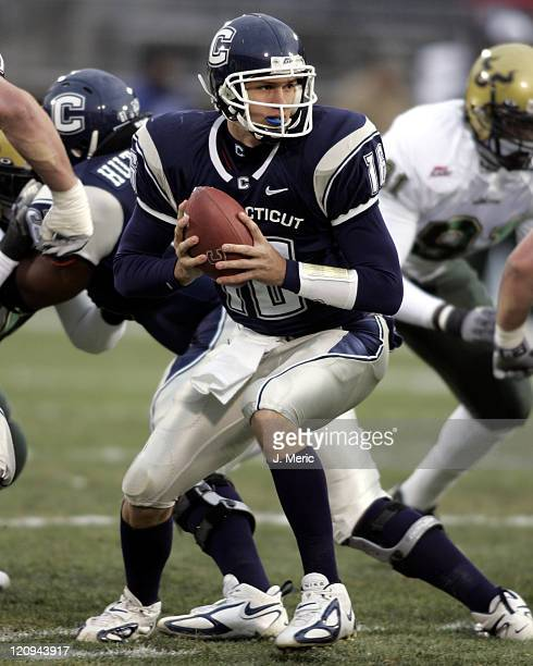 University of Connecticut quarterback Matt Bonislawski looks to make a play in Saturday's game against South Florida at Rentschler Field in East...