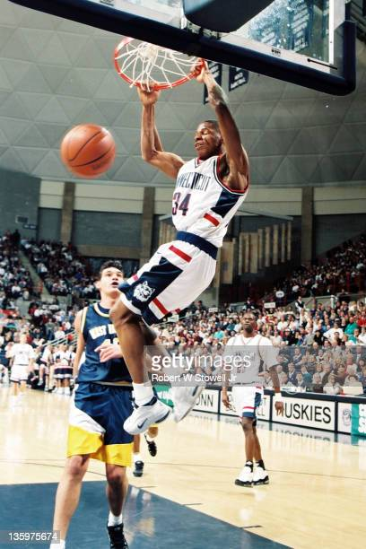 University of Connecticut star player Ray Allen dunks home two points in a game against West Virginia Storrs CT 1996