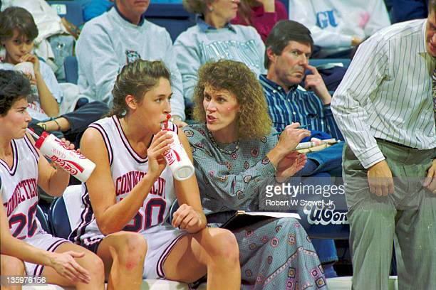 University of Connecticut star player Rebecca Lobo and associate head coach Chris Dailey right discuss the game while on the bench Storrs CT 1996