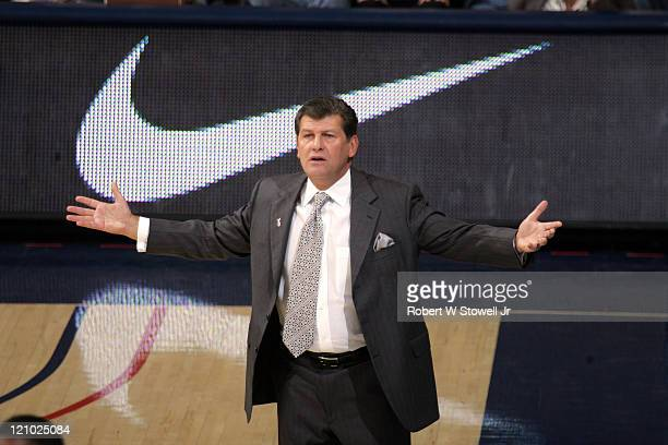 University of Connecticut women's basketball coach Geno Auriemma gestures as he questions a call during a game at Gampel Pavilion in Storrs...